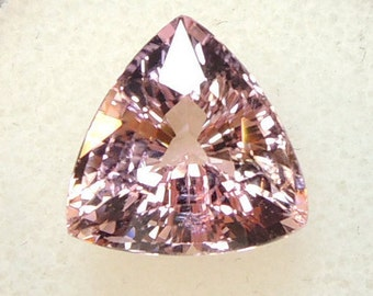 Carved tourmaline trillion, pink tourmaline, purple with orange highlights, Africa, 5 48cts approximately 11.5 mm