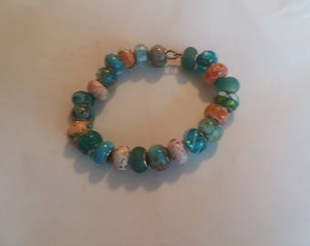 Beautiful glass circle beads in blue and orange tones