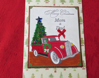 "Merry Christmas Mom & Dad, bringing home the Christmas Tree, ""Wishing you the Merriest Christmas andthe Happiest New Year!"""