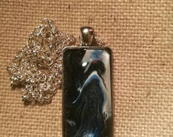 Handmade pendant containing an original abstract painting.
