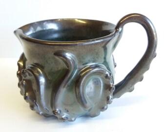 metallic green octopitcher, the octopus pitcher!