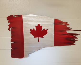 Tattered aluminum Canadian flag
