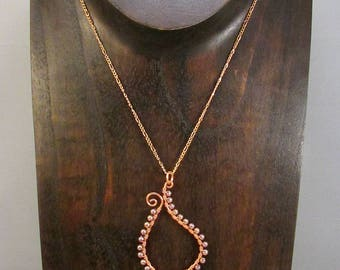 Copper paisley outline with beads necklace