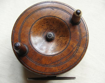A nice old vintage antique fly fishing reel 19th century wood and brass reel