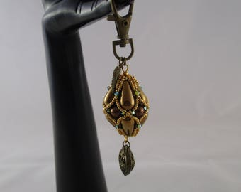 Keychain pendant bronze with a charm