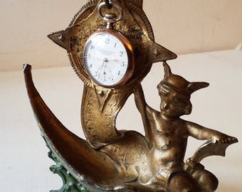 Pocket watch display....metal with angel on boat