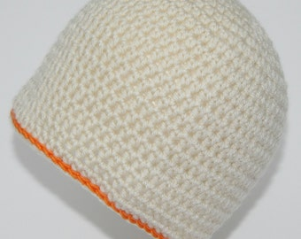 Classic cream/off white  beanie with a bright orange stripe.  Boys or girls crochet ski hat to suit 4 to 6 months. Warm childs's/baby's hat.
