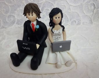 Customized bride and groom playing computer wedding cake topper