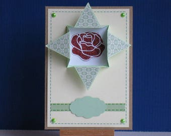 card with a frame 3D with a rose inside