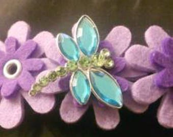 Hairpin purple flowers with dragonfly