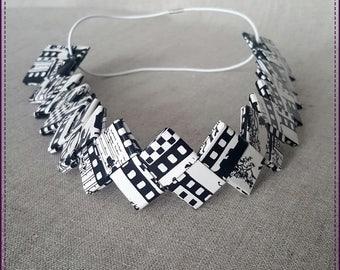 "Headband, a band of paper, laminated, ""movies"" theme"