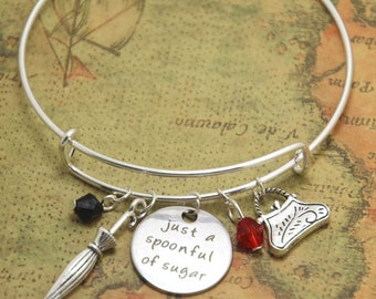 Mary Poppins ladies bangle bracelet. With umbrella, handbag and spoonful of sugar charms