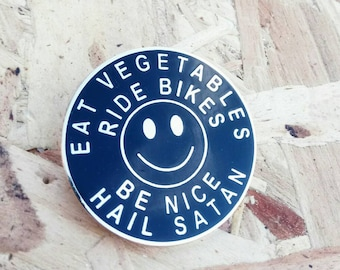 Ride Bikes / Eat Veg / Be Nice / Hail Satan enamel pin in gold and black