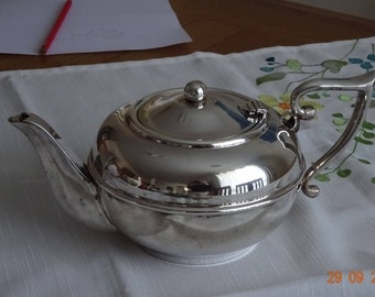 A Vintage Perfection Silverplate Teapot