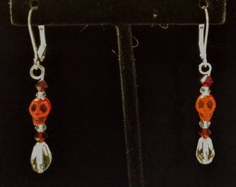 Red skull earrings on stainless steel