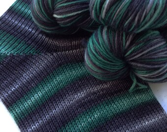 Hand dyed self striping merino sock yarn - Talk to Snakes