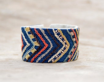 Hand embroidered  textile cuff. Blue textile bracelet with coral and beige embroidery.