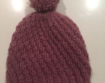 Hand knitted seamless hat for children 3-8 years old.