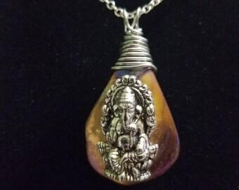 Ganesha on abalone necklace.