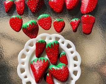 Hand painted strawberry rocks.