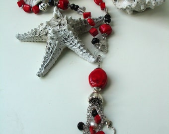 Beautiful lariat necklace with red bamboo coral, black crystals and white freshwater pearls