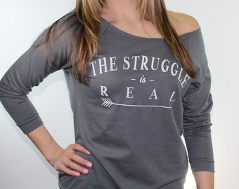 off the shoulder top. gym sweatshirt. the struggle is real. graphic tees for women. lightweight sweatshirt. fitness apparel.