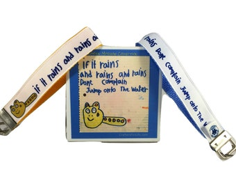 If It Rains Key Chain / Keyfob with blue or gold backing and a sturdy 12 inch wrist loop - made by Adults with Special Needs