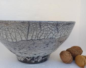 Raku Bowl. Refractory mud. Handmade Potter Lathe
