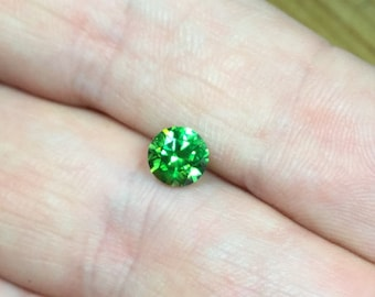 Demantoid 0,87ct., D-5,7mm.