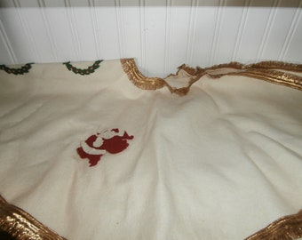 Vintage felt Christmas  tree skirt 27 inches round cream colored with gold trim and appliques not finished as is
