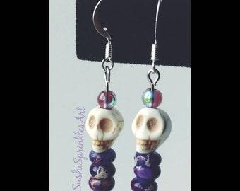 Purple dangle skull earrings