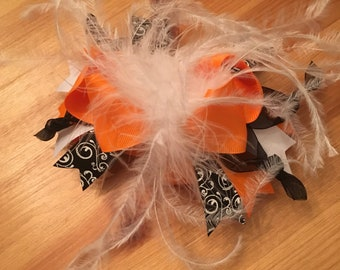 Black and orange feather bow hair clip