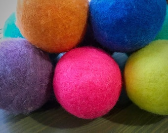 Ovella Wool Dryer Balls: The Doces Collection set of Nine (9) bright, colorful, solid colors, pink, purple, green, blue, orange, yellow, red