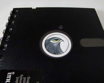 """Recycled Geek Gear Computer Floppy Disk Notebook 5 1/4"""" with Reproduction Artwork of a Black Big Eyed Bird"""