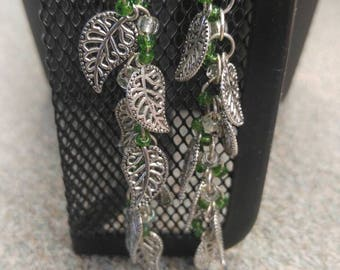 Long silver and green, leaf motif earrings