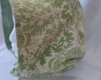 reversible cowl hood- green on one side, cream with green flowers on the other
