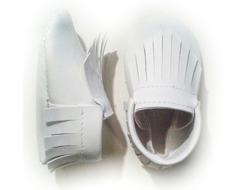 solid white moccasins