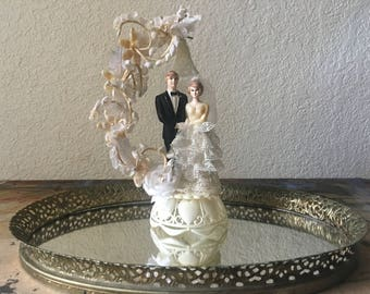 Vintage wedding cake topper, bride and groom with arch and bell