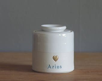 custom urn. quote with gold infilled stamp, and lid, straight shaped urn with custom name. modern urn for ashes. white with blue