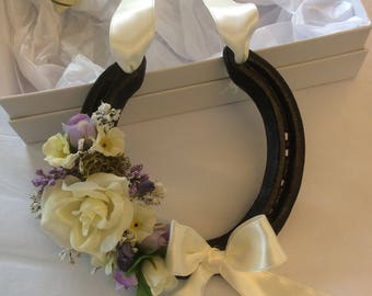Real decorated ivory wedding horseshoe in luxury box
