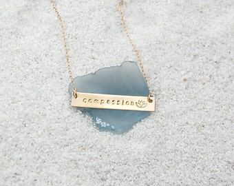 Compassion gold bar with lotus necklace