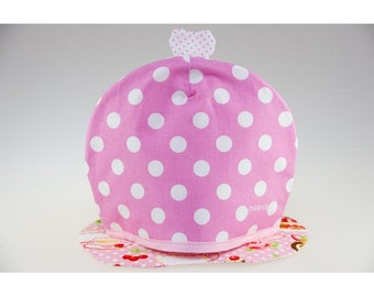 Covers teapot big white polka dots pink cotton and isolating his carpet.
