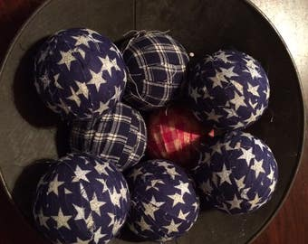 "3"" rag balls in antique strainer"