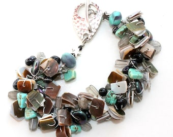 seashells found turquoise. bracelet. wire wrapped gemstones gift. textural art. bracelet. teal and brown. patterned beaded jewelry
