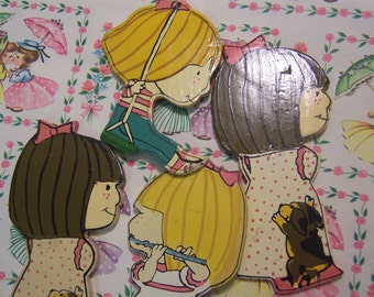 four little wooden cutouts