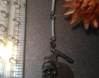 Vintage dead-stock pewter axe and skull dangler