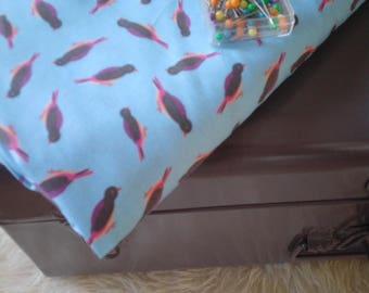 Birds on blue print fabric