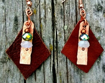 Brown leather and copper earrings with copper, green, and opaque beaded accents.