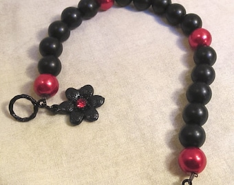 Black and Red Glass Pearl Bracelet With Flower Charm
