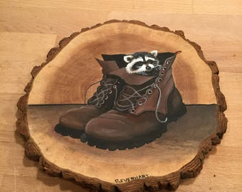 Adorable Raccoon in boots painting on a wood slice.. by C.Everhart.